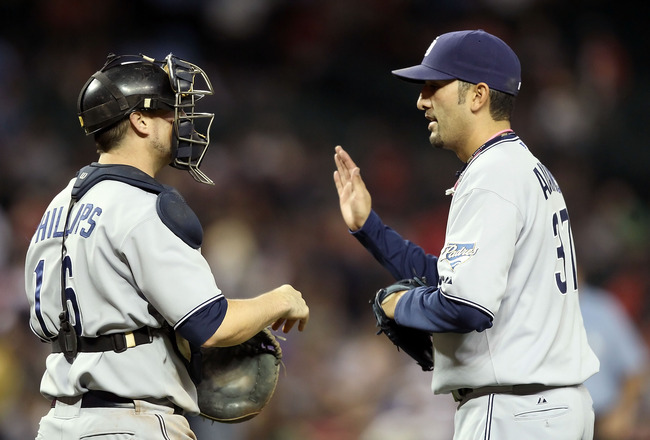 PHOENIX, AZ - MAY 16:  Relief pitcher Mike Adams #37 of the San Diego Padres high fives catcher Kyle Phillips #16 after defeating the Arizona Diamondbacks during the Major League Baseball game at Chase Field on May 16, 2011 in Phoenix, Arizona. The Padres