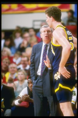 1989-1990:  Notre Dame Fighting Irish coach Digger Phelps confers with a player during a game. Mandatory Credit: Stephen Dunn  /Allsport