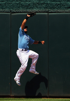 KANSAS CITY, MO - JULY 10:  Melky Cabrera #53 of the Kansas City Royals catches a fly ball at the centerfield wall during the game against the Detroit Tigers on July 10, 2011 at Kauffman Stadium in Kansas City, Missouri.  (Photo by Jamie Squire/Getty Imag