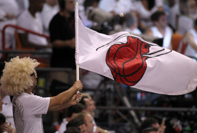 MIAMI, FL - MAY 31:  A Miami Heat fan waves a flag in the second half while the Heat take on the Dallas Mavericks in Game One of the 2011 NBA Finals at American Airlines Arena on May 31, 2011 in Miami, Florida. NOTE TO USER: User expressly acknowledges an