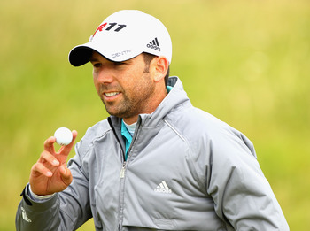SANDWICH, ENGLAND - JULY 17:  Sergio Garcia of Spain reacts to the crowd on the first hole during the final round of The 140th Open Championship at Royal St George's on July 17, 2011 in Sandwich, England.  (Photo by Scott Halleran/Getty Images)