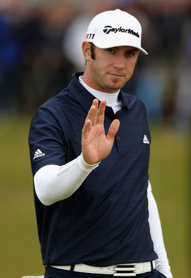 SANDWICH, ENGLAND - JULY 17:   Dustin Johnson of the United States reacts on the 11th green during the final round of The 140th Open Championship at Royal St George's on July 17, 2011 in Sandwich, England. (Photo by Andrew Redington/Getty Images)