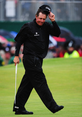 SANDWICH, ENGLAND - JULY 17:  Phil Mickelson of the United States reacts to his putt on the 18th green during the final round of The 140th Open Championship at Royal St George's on July 17, 2011 in Sandwich, England.  (Photo by Stuart Franklin/Getty Image