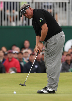 SANDWICH, ENGLAND - JULY 17:  Darren Clarke of Northern Ireland putts on his way to victory on the 18th green during the final round of The 140th Open Championship at Royal St George's on July 17, 2011 in Sandwich, England.  (Photo by Andrew Redington/Get