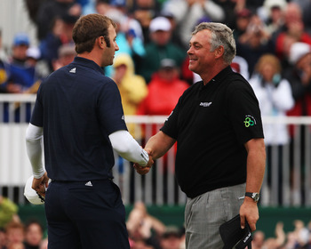 SANDWICH, ENGLAND - JULY 17:  Darren Clarke of Northern Ireland shakes hands with Dustin Johnson (L) of the United States after his victory on the 18th green during the final round of The 140th Open Championship at Royal St George's on July 17, 2011 in Sa