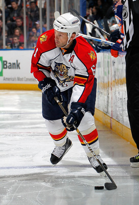 UNIONDALE, NY - FEBRUARY 21:  Cory Stillman #61 of the Florida Panthers looks to pass during an NHL hockey game against the New York Islanders at the Nassau Coliseum on February 21, 2011 in Uniondale, New York.  (Photo by Paul Bereswill/Getty Images)