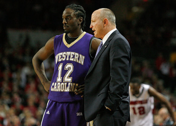 LOUISVILLE, KY - DECEMBER 12: Mike Williams #12 of the Western Carolina Catamounts talks with Larry Hunter the Head Coach during the game against the Louisville Cardinals on December 12, 2009 at Freedom Hall in Louisville, Kentucky. Western Carolina won 9