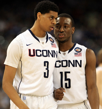 HOUSTON, TX - APRIL 04:  Jeremy Lamb #3 and Kemba Walker #15 of the Connecticut Huskies talk against the Butler Bulldogs during the National Championship Game of the 2011 NCAA Division I Men's Basketball Tournament at Reliant Stadium on April 4, 2011 in H