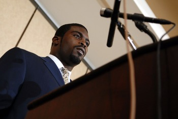 RICHMOND, VA - AUGUST 27:  Atlanta Falcons quarterback Michael Vick speaks to reporters at the Omni Richmond Hotel after agreeing to a guilty plea on charges stemming from his involvement in a dogfighting ring August 27, 2007, in Richmond, Virginia.  (Pho