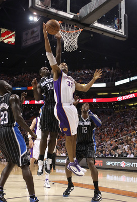 PHOENIX, AZ - MARCH 13:  Grant Hill #33 of the Phoenix Suns lays up a shot against the Orlando Magic during the NBA game at US Airways Center on March 13, 2011 in Phoenix, Arizona.  NOTE TO USER: User expressly acknowledges and agrees that, by downloading