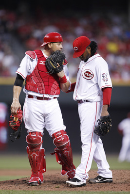 CINCINNATI, OH - JULY 15: Ramon Hernandez #55 of the Cincinnati Reds talks with starting pitcher Johnny Cueto #47 during the game against the St. Louis Cardinals at Great American Ball Park on July 15, 2011 in Cincinnati, Ohio. Cincinnati won 6-5. (Photo