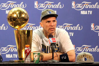 MIAMI, FL - JUNE 12:  Jason Kidd #2 of the Dallas Mavericks answers questions from the media as the Larry O'Brien Championship trophy sits on the table during a post game news conference after the Mavericks won 105-95 against the Miami Heat in Game Six of