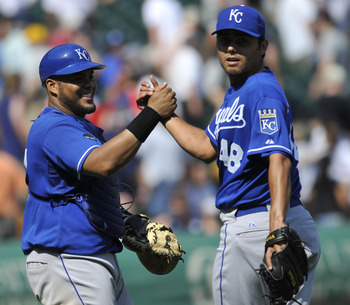 CHICAGO, IL - JULY 06:  Joakim Soria # 48 of the Kansas City Royals and Brayan Pena #27 celebrate after beating the Chicago White Sox on July 6, 2011 at U.S. Cellular Field in Chicago, Illinois. The Royals defeated the White Sox 4-1  (Photo by David Banks