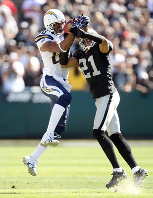 OAKLAND, CA - OCTOBER 10:  Malcom Floyd #80 of the San Diego Chargers catches a ball while defended by Nnamdi Asomugha #21 of the Oakland Raiders at Oakland-Alameda County Coliseum on October 10, 2010 in Oakland, California.  (Photo by Ezra Shaw/Getty Ima