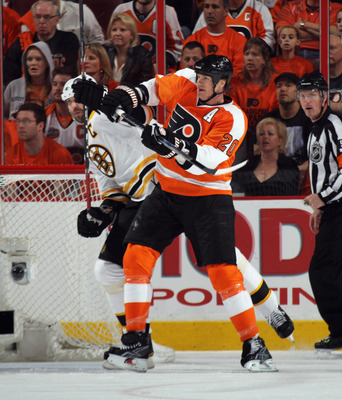 PHILADELPHIA, PA - APRIL 30: Chris Pronger #20 of the Philadelphia Flyers hits Zdeno Chara #33 of the Boston Bruins in Game One of the Eastern Conference Semifinals during the 2011 NHL Stanley Cup Playoffs at the Wells Fargo Center on April 30, 2011 in Ph
