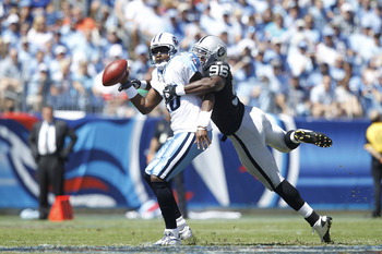 NASHVILLE - SEPTEMBER 12: Vince Young #10 of the Tennessee Titans gets sacked by Kamerion Wimbley #96 of the Oakland Raiders in the first half of the NFL season opener at LP Field on September 12, 2010 in Nashville, Tennessee. (Photo by Joe Robbins/Getty
