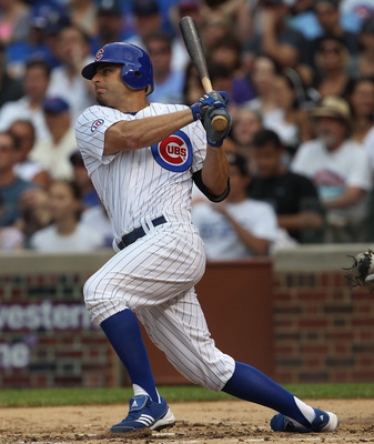 CHICAGO, IL - JULY 01: Reed Johnson #5 of the Chicago Cubs hits the ball against the Chicago White Sox at Wrigley Field on July 1, 2011 in Chicago, Illinois. The White Sox defeated the Cubs 6-4. (Photo by Jonathan Daniel/Getty Images)