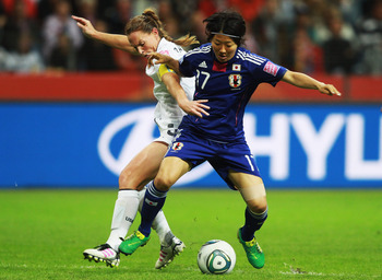FRANKFURT AM MAIN, GERMANY - JULY 17: Yuki Nagasato (R) of Japan and Christie Rampone of USA battle for the ball during the FIFA Women's World Cup Final match between Japan and USA at the FIFA World Cup stadium Frankfurt on July 17, 2011 in Frankfurt am M