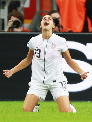 FRANKFURT AM MAIN, GERMANY - JULY 17: Alex Morgan of USA celebrates after scoring her team's first goal during the FIFA Women's World Cup Final match between Japan and USA at the FIFA World Cup stadium Frankfurt on July 17, 2011 in Frankfurt am Main, Germ