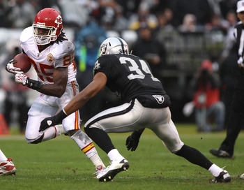 OAKLAND, CA - NOVEMBER 07:  Jamaal Charles #25 of the Kansas City Chiefs runs against Mike Mitchell #34 of the Oakland Raiders during an NFL game at Oakland-Alameda County Coliseum on November 7, 2010 in Oakland, California.  (Photo by Jed Jacobsohn/Getty