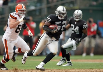 OAKLAND, CA - SEPTEMBER 23: Kirk Morrison #52 of the Oakland Raiders carries the ball during an NFL game against the Cleveland Browns at McAfee Coliseum September 23, 2007 in Oakland, California. (Photo by Jed Jacobsohn/Getty Images)