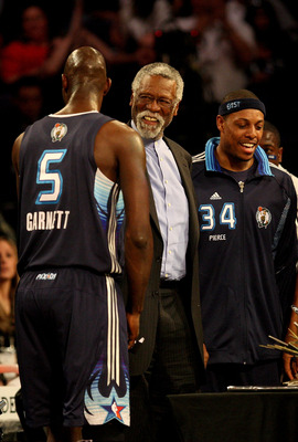 PHOENIX - FEBRUARY 15:  Kevin Garnett #5 and Paul Pierce #34 of the Eastern Conference present a birthday cake to NBA legend Bill Russell, center, during the 58th NBA All-Star Game, part of 2009 NBA All-Star Weekend at US Airways Center on February 15, 20