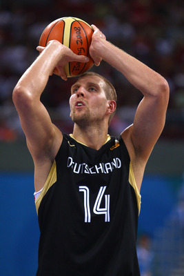 BEIJING - AUGUST 12:  Dirk Nowitzki #14 of Germany shoots a free throw against Greece during the preliminary round of the basketball event held at the Beijing Olympic Basketball Gymnasium during Day 4 of the Beijing 2008 Olympic Games on August 12, 2008 i