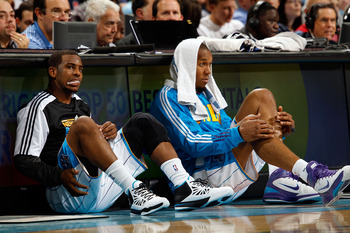 NEW ORLEANS, LA - DECEMBER 26:  Chris Paul #3 and David West #30 of the New Orleans Hornets sit on the floor before being substituted into the game while playing the Atlanta Hawks at the New Orleans Arena on December 26, 2010 in New Orleans, Louisiana.  N