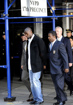 NEW YORK - DECEMBER 1:  Wide receiver Plaxico Burress (2L) of the New York Giants is led to a squad car for transport to his arraignment outside the NYPD 17th Precinct December 1, 2008 in New York City. Burress, who is expected to face a charge of crimina