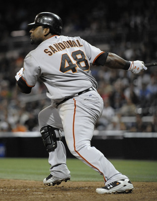 SAN DIEGO, CA - JULY 14: Pablo Sandoval #48 of the San Francisco Giants hits an RBI single during the 12th inning of  a baseball game against the San Diego Padres at Petco Park on July 14, 2011 in San Diego, California. The Giants won 6-2.   (Photo by Den