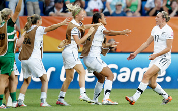 Hannah Wilkinson (17) celebrates after her 94th minute goal against Mexico