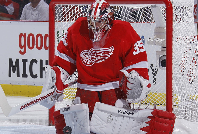 DETROIT - MAY 10: Jimmy Howard #35 of the Detroit Red Wings stops a first period shot by the San Jose Sharks of Game Six of the Western Conference Semifinals during the 2011 NHL Stanley Cup Playoffs on May 10, 2011 at Joe Louis Arena in Detroit, Michigan.