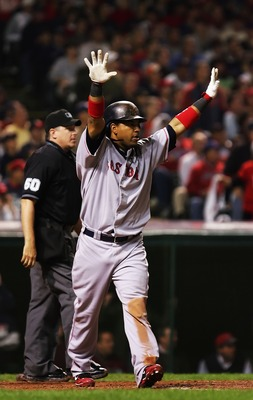 CLEVELAND - OCTOBER 16:  Manny Ramirez #24 of the Boston Red Sox celebrates after hitting a home run in the sixth inning against the Cleveland Indians during Game Four of the American League Championship Series at Jacobs Field on October 16, 2007 in Cleve