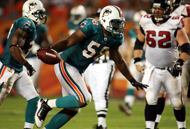 MIAMI - AUGUST 27: Linebacker Karlos Dansby #58 of the Miami Dolphins celebrates his fumble recovery against the Atlanta Falcons during preseason action at Sun Life Stadium on August 27, 2010 in Miami, Florida.  (Photo by Marc Serota/Getty Images)
