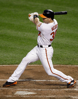 BALTIMORE, MD - JUNE 28: Luke Scott #30 of the Baltimore Orioles at the plate against the St. Louis Cardinals at Oriole Park at Camden Yards on June 28, 2011 in Baltimore, Maryland.  (Photo by Rob Carr/Getty Images)