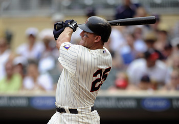 MINNEAPOLIS, MN - JULY 17: Jim Thome #25 of the Minnesota Twins hits a three-run home run against the Kansas City Royals in the sixth inning on July 17, 2011 at Target Field in Minneapolis, Minnesota. (Photo by Hannah Foslien/Getty Images)