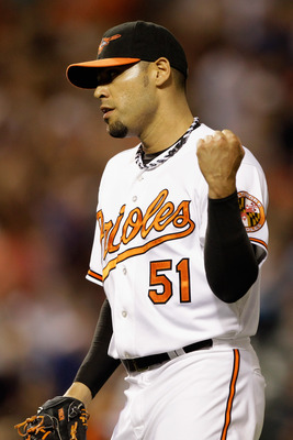 BALTIMORE, MD - JULY 16: Relief pitcher Mike Gonzalez #51 of the Baltimore Orioles reacts after getting the last out to defeat the Cleveland Indians 6-5 at Oriole Park at Camden Yards on July 16, 2011 in Baltimore, Maryland.  (Photo by Rob Carr/Getty Imag