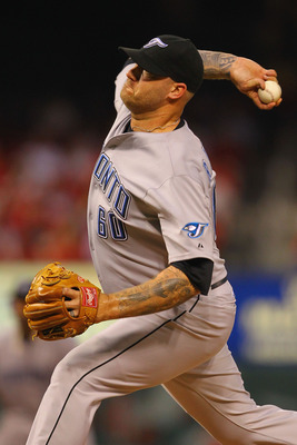 ST. LOUIS, MO - JUNE 25: Reliever Jon Rauch #60 of the Toronto Blue Jays pitches against the St. Louis Cardinals at Busch Stadium on June 25, 2011 in St. Louis, Missouri.  (Photo by Dilip Vishwanat/Getty Images)