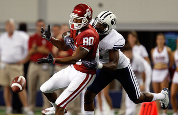 ARLINGTON, TX - SEPTEMBER 05:  Defensive back Brandon Bradley #5 of the Brigham Young Cougars defends the play against Adron Tennell #80 of the Oklahoma Sooners at Cowboys Stadium on September 5, 2009 in Arlington, Texas.  (Photo by Ronald Martinez/Getty
