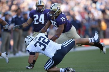 SEATTLE - SEPTEMBER 6:  Darin Harris #15 of the Washington Huskies puts a hit on Dennis Pitta #32 of the BYU Cougars during their game on September 6, 2008 at Husky Stadium in Seattle, Washington. The Cougars defeated the Huskies 28-27. (Photo by Otto Gre