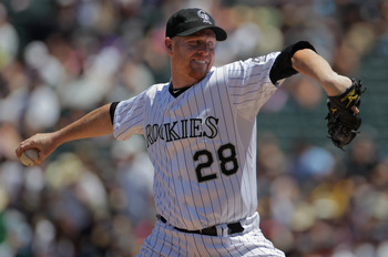 DENVER, CO - JULY 17:  Starting pitcher Aaron Cook #28 of the Colorado Rockies delviers against the Milwaukee Brewers at Coors Field on July 17, 2011 in Denver, Colorado.  (Photo by Doug Pensinger/Getty Images)