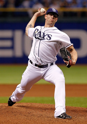 ST. PETERSBURG, FL - JULY 15:  Pitcher Kyle Farnsworth #43 of the Tampa Bay Rays pitches against the Boston Red Sox during the game at Tropicana Field on July 15, 2011 in St. Petersburg, Florida.  (Photo by J. Meric/Getty Images)