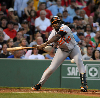 BOSTON, MA - JULY 9: Vladimir Guerrero #27 of the Baltimore Orioles strikes out in the fourth inning against the Boston Red Sox at Fenway Park on July 9, 2011 in Boston, Massachusetts. (Photo by Darren McCollester/Getty Images)