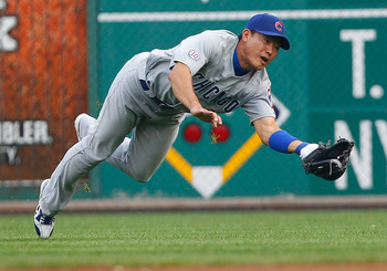 PITTSBURGH - JULY 08:  Kosuke Fukudome #1 of the Chicago Cubs makes a diving catch in center field against the Pittsburgh Pirates during the game on July 8, 2011 at PNC Park in Pittsburgh, Pennsylvania.  (Photo by Jared Wickerham/Getty Images)