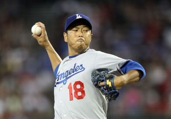 PHOENIX, AZ - JULY 16:  Starting pitcher Hiroki Kuroda #18 of the Los Angeles Dodgers pitches against the Arizona Diamondbacks during the Major League Baseball game at Chase Field on July 16, 2011 in Phoenix, Arizona.  (Photo by Christian Petersen/Getty I