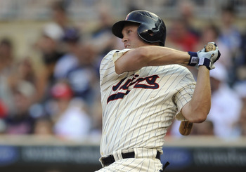 MINNEAPOLIS, MN - JULY 16: Michael Cuddyer #5 of the Minnesota Twins hits a single against the Kansas City Royals in the first inning on July 16, 2011 at Target Field in Minneapolis, Minnesota. The Twins defeated the Royals 4-3. (Photo by Hannah Foslien/G