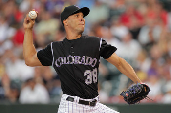DENVER, CO - JULY 14:  Starting pitcher Ubaldo Jimenez #38 of the Colorado Rockies delivers against the Milwaukee Brewers at Coors Field on July 14, 2011 in Denver, Colorado.  (Photo by Doug Pensinger/Getty Images)