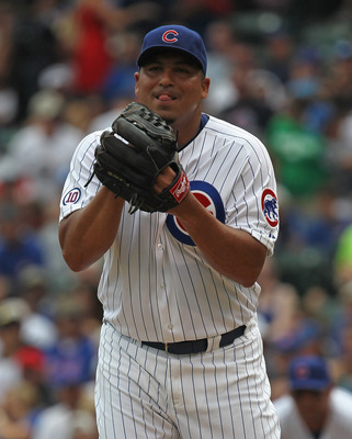CHICAGO, IL - JULY 16:  Starting pitcher Carlos Zambrano #38 of the Chicago Cubs prepares to deliver the ball against the Florida Marlins at Wrigley Field on July 16, 2011 in Chicago, Illlinois.  (Photo by Jonathan Daniel/Getty Images)