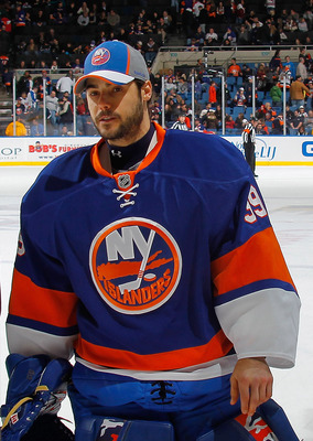 UNIONDALE, NY - NOVEMBER 20:  Rick DiPietro #39 of the New York Islanders, who did not play in the game, skates to the doorway to leave the ice after the second period of a hockey game against the Florida Panthers at the Nassau Coliseum on November 20, 20