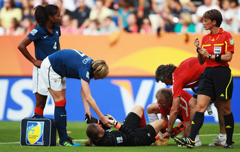 SINSHEIM, GERMANY - JULY 16: Berangere Sapowicz  (C) of France is seen injured during the FIFA Women's 3rd Place Playoff match between Sweden and France at Rhein-Neckar Arena on July 16, 2011 in Sinsheim, Germany.  (Photo by Joern Pollex/Getty Images)